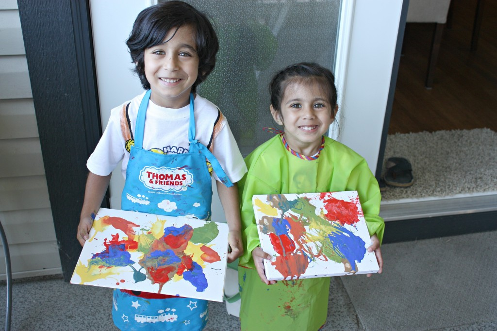Kids showing straw painting
