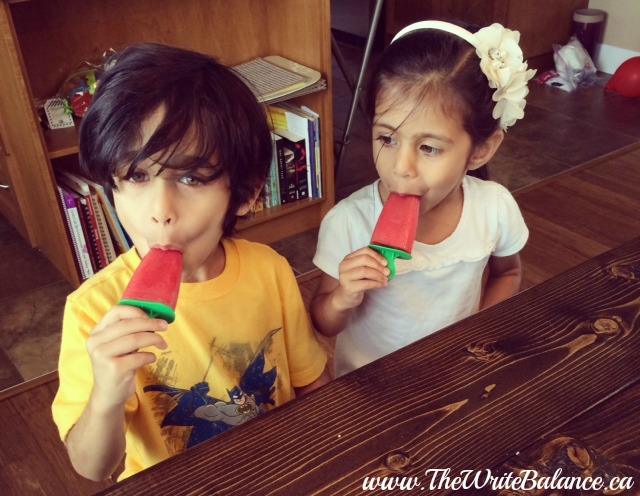 kids eating watermelon popsicles