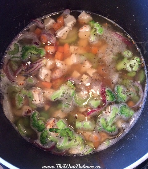 chicken noodle soup simmering