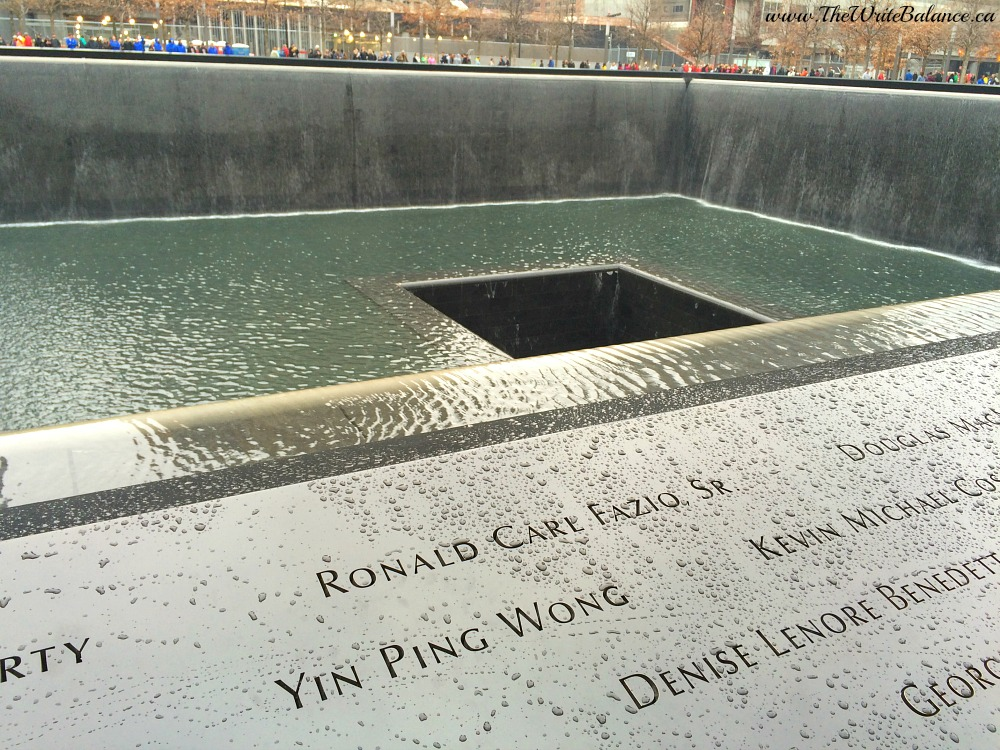 One of the Memorial's twin reflecting pools with the names of every person who died in the 2001 and 1993 attacks are inscribed into bronze panels edging.