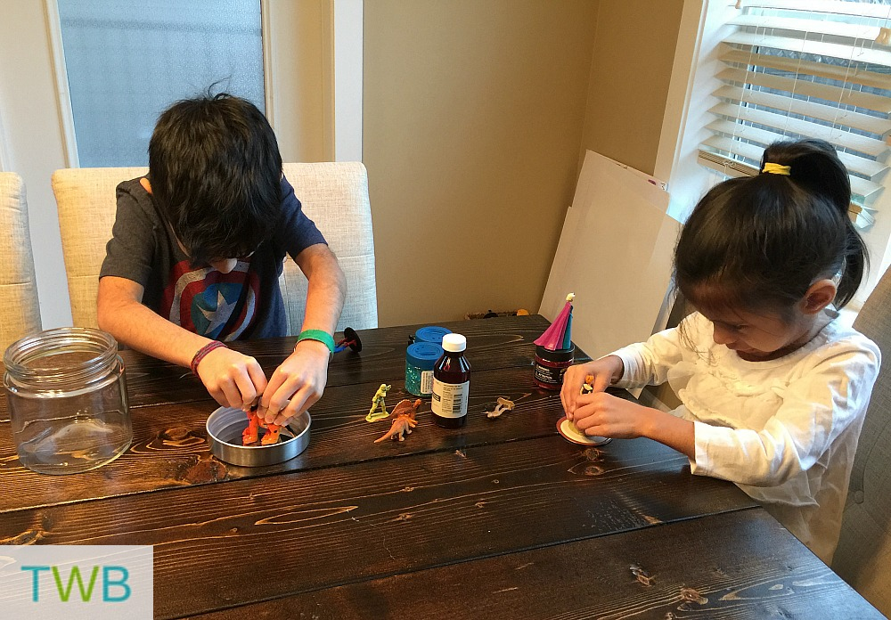 Homemade Snow globes - glueing on the figure